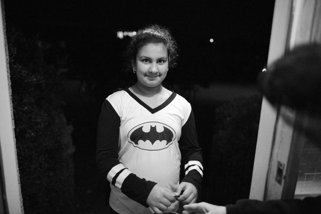 Girl in her tween years wearing a Batman t-shirt